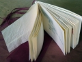 handgemachtes Künstlerbuch mit umlaufenden Umschlag mit Taschen und japanischer Blockheftung 2